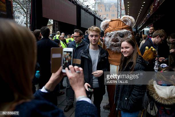 Fans pose with an Ewok ahead of the European Premiere of Star Wars The Force Awakens in central London on December 16 2015 Ever since 1977 when Star...