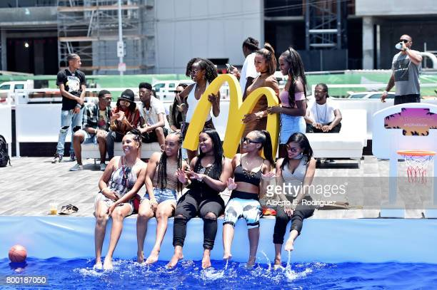 Fans pose with McDonald's branding at day one of the Pool Groove sponsored by McDonald's during the 2017 BET Experience at Gilbert Lindsey Plaza on...