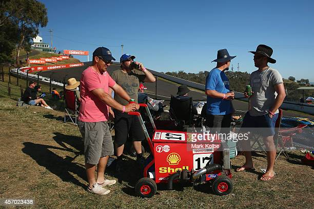 Fans pose with their during their modified esky during V8 Supercars Bathurst 1000 weekend at Mount Panorama on October 11 2014 in Bathurst Australia