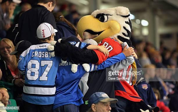 Fans pose with Washington Capitals mascot Slapshot at Yardman Arena during Kraft Hockeyville Day 2 on September 14 2013 in Belleville Ontario Canada