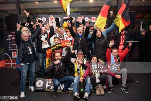 Fans posing with Paula the DFB mascot prior the International Friendly between Germany and Argentina at Signal Iduna Park on October 9, 2019 in...