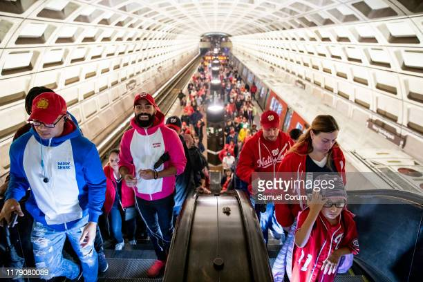 Fans pour out of the Metro cars at the Navy Yard/Ballpark Metro station where they will be watching Game 7 of the World Series on October 30 2019 in...