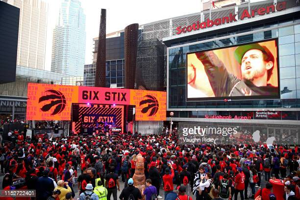 Fans prepare for Game One of the 2019 NBA Finals between the Toronto Raptors and the Golden State Warriors in the Jurassic Park fan area outside...
