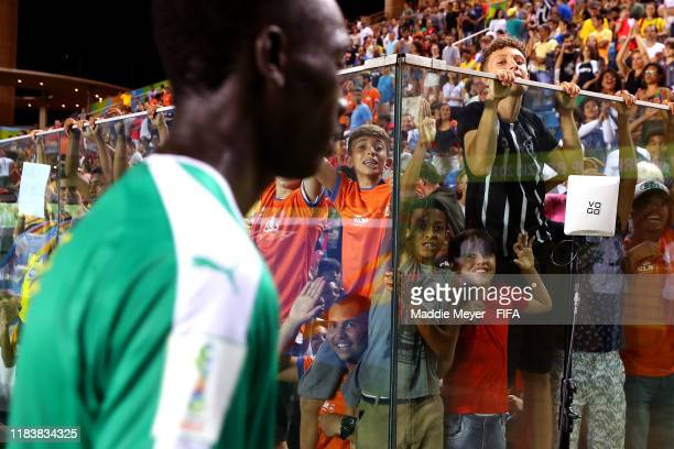 Fans press against the glass trying to get the attention of Senegal players after the Group D Match between USA and Senegal in the FIFA U17 World Cup...