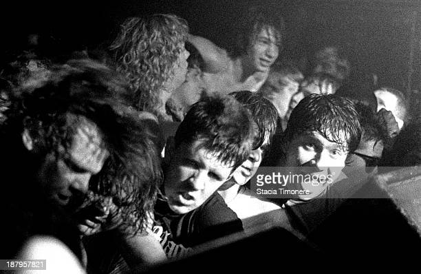 Fans press up against the front of the stage while DRI performs at Medusas in Chicago Illinois USA on 11th June 1987
