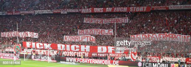 Fans protest against the DFB with banners during the Bundesliga match between FC Bayern Muenchen and Bayer 04 Leverkusen at Allianz Arena on August...