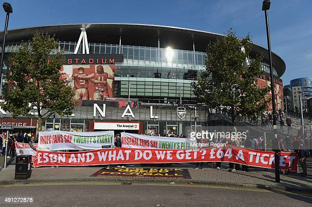 Fans protest at ticket prices at the Emirates ahead of the Barclays Premier League match between Arsenal and Manchester United at Emirates Stadium on...