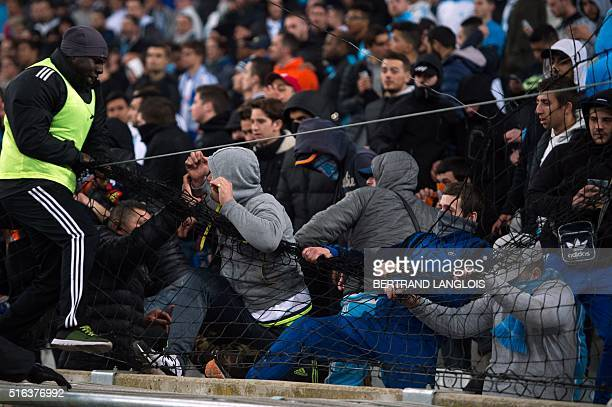 OM fans protest during the French L1 football match Olympique de Marseille vs Rennes on March 18 2016 at the Velodrome stadium in Marseille southern...