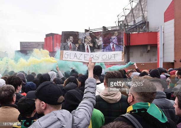 Fans protest outside of Old Trafford on May 13, 2021 in Manchester, England. Police and ground security staff are prepared for a possible...