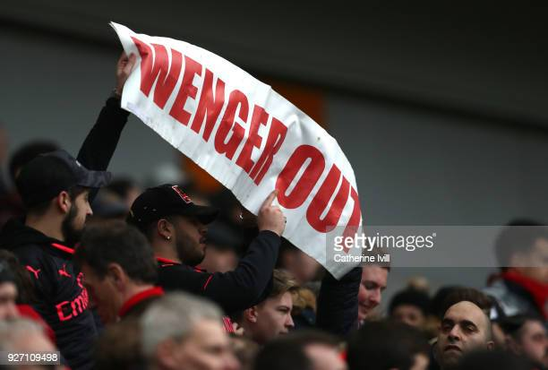 Fans protest towards Arsene Wenger Manager of Arsenal following the Premier League match between Brighton and Hove Albion and Arsenal at Amex Stadium...