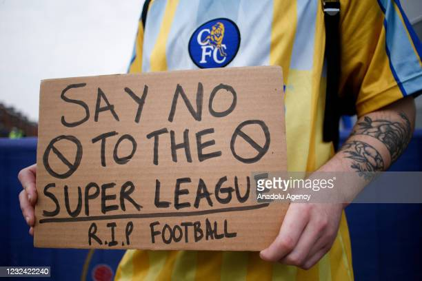 Fans protesting the establishment of the breakaway European Super League demonstrate outside Stamford Bridge stadium, home of Chelsea Football Club,...