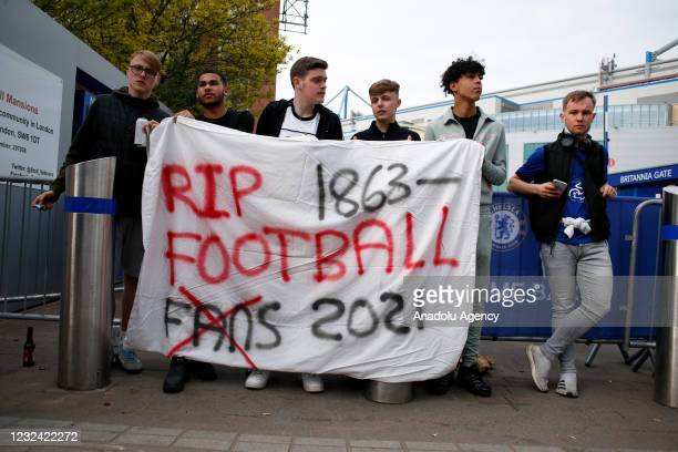 Fans protesting the establishment of the breakaway European Super League demonstrate outside Stamford Bridge stadium, home of Chelsea Football Club,...