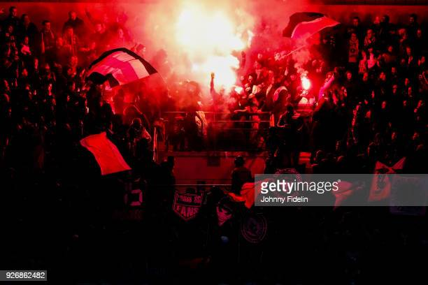 Fans PSG smoke fire during the Ligue 1 match between Troyes AC and Paris Saint Germain at Stade de l'Aube on March 3 2018 in Troyes