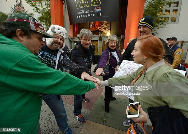 Fans put their hands in the center before the opening night of Walt Disney Pictures and Lucasfilm's Star Wars The Force Awakens at TCL Chinese...