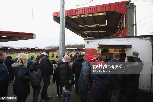 Fans queue for refreshments during The Emirates FA Cup Third Round match between Stevenage and Reading at The Lamex Stadium on January 6 2018 in...