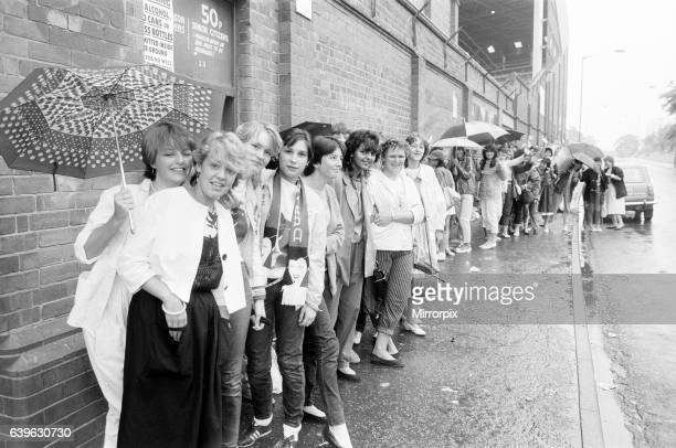 Fans queue outside football ground ahead of Duran Duran Concert at Villa Park Birmingham Saturday 23rd July 1983