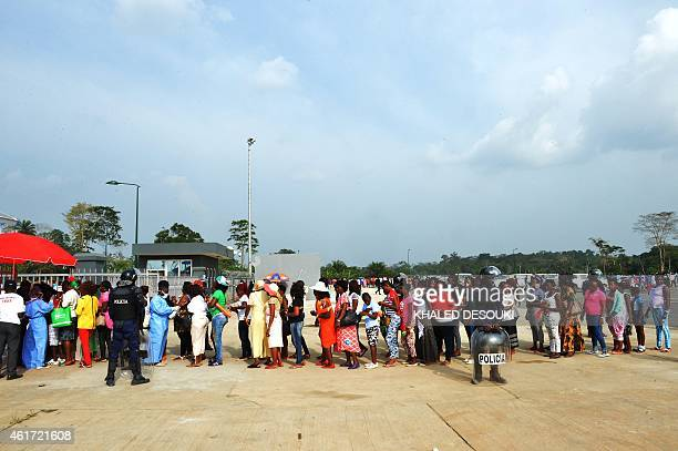 Fans queue outside the stadium prior to the 2015 African Cup of Nations group B football match between Zambia and Democratic Republic of the Congo in...