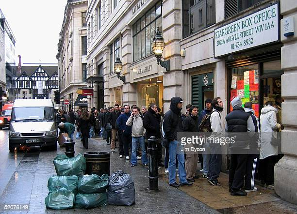 Fans queue to buy U2 tickets, at the Stargreen Box Office, for the group's Twickenham concerts in June, January 28, 2005 in Central London.