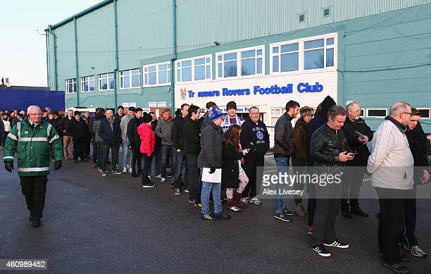 Fans queue up outside the ground prior to the FA Cup Third Round match between Tranmere Rovers and Swansea City at Prenton Park on January 3 2015 in...