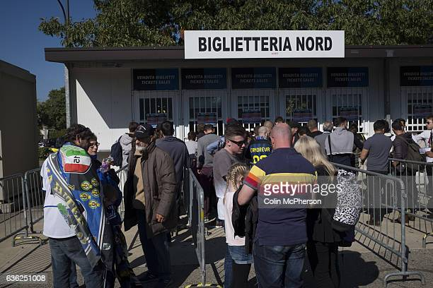Fans queueing for match tickets outside the Stadio Giuseppe Meazza also known as the San Siro before Internationale took on Cagliari in an Italian...