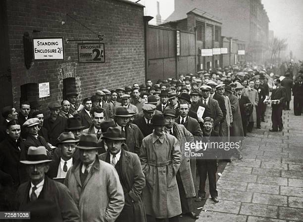Fans queuing at the Arsenal Stadium in Highbury for an F A Cup tie against Bolton Wanderers 8th January 1938 Arsenal won the match 31