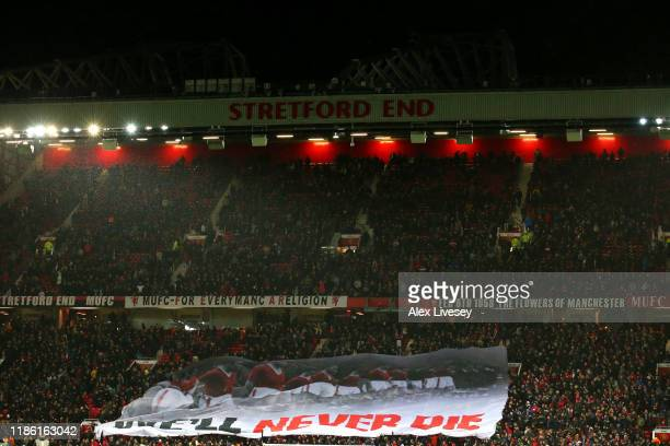 Fans raise a banner in support during the UEFA Europa League group L match between Manchester United and Partizan at Old Trafford on November 07 2019...