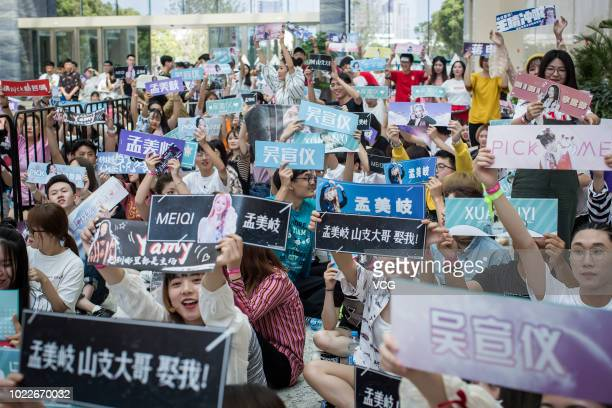 Fans raising banners to cheer for idols before the second public performance on May 14, 2018 in Hangzhou, Zhejiang Province of China. Produce 101...