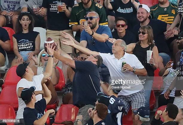 TORONTO ON AUGUST 20 Fans reach for a field goal as the Toronto Argonauts play the Edmonton Eskimos at BMO Field in Toronto August 20 2016
