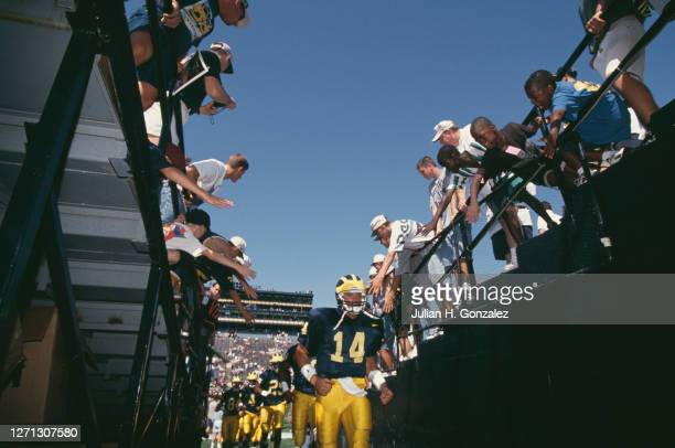Fans reach out to Brian Griese Quarterback for the University of Michigan Wolverines as he walks down the tunnel after the NCAA Division I-A Big 10...