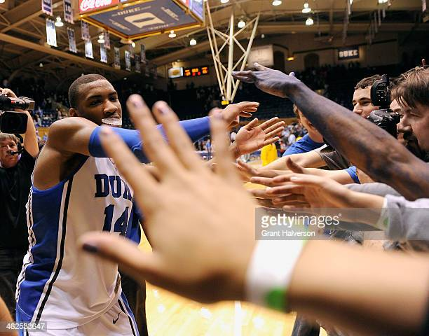 Fans reach out to highfive Rasheed Sulaimon of the Duke Blue Devils as he leaves the floor after a lastsecond win over the Virginia Cavaliers during...