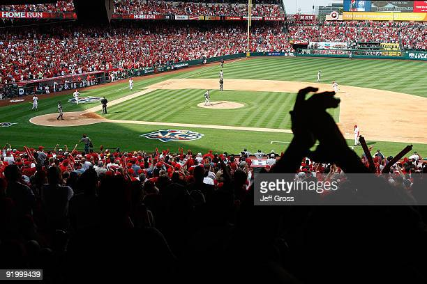 Fans react after Howie Kendrick of the Los Angeles Angels of Anaheim hits a home run off Andy Pettitte of the New York Yankees during the fifth...