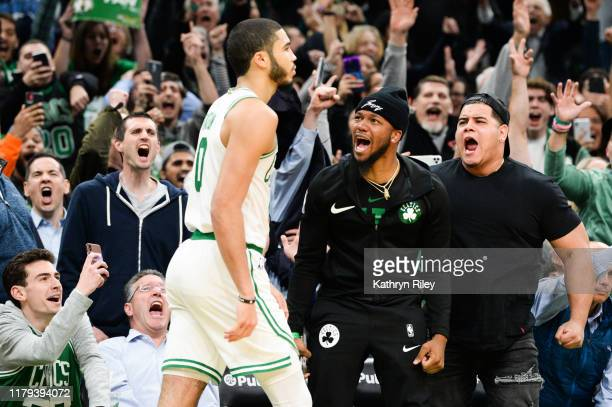 Fans react after Jayson Tatum of the Boston Celtics hit the game winning shot against the New York Knicks in the second half at TD Garden on November...