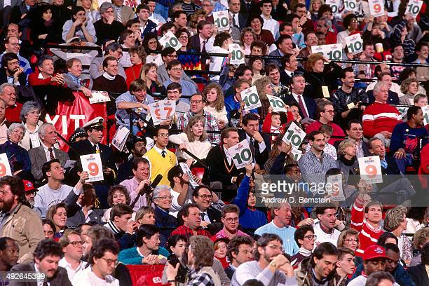 Fans react after Michael Jordan of the Chicago Bulls attempts a dunk during the 1988 Slam Dunk Contest as part of AllStar Weekend on February 6 1988...