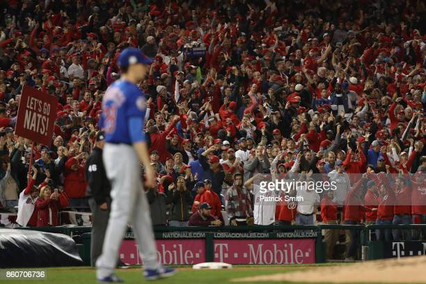 Fans react after Michael Taylor of the Washington Nationals hit a three run home run against the Chicago Cubs during the second inning in game five...