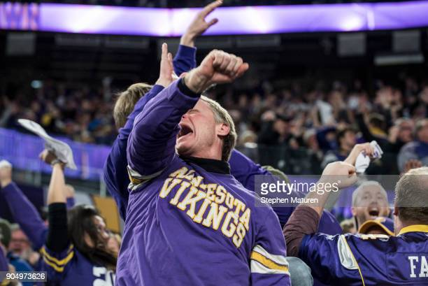 Fans react after Stefon Diggs of the Minnesota Vikings scored a 61 yard touchdown at the end of the fourth quarter of the NFC Divisional Playoff game...