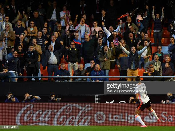 Fans react after the celebration of the third goal by Joao Cancelo of Valencia during the La Liga match between Valencia CF and Deportivo de La...