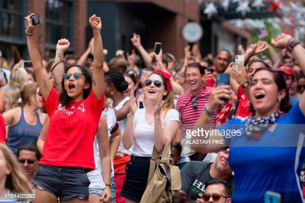 Fans react after the final whistle as they watch the France 2019 Women's World Cup final football match between USA and the Netherlands, in...