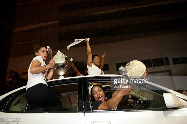 Fans react after the Miami Heat won the NBA title against the San Antonio Spurs June 20 2013 in Miami Florida The Heat won back to back championships