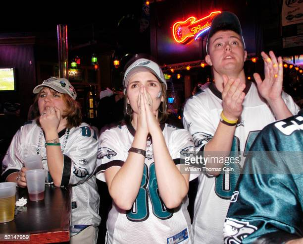 Fans react after the Philadelphia Eagles were defeated by the New England Patriots in Super Bowl XXXIX at Chickie's and Pete's bar and restaurant...
