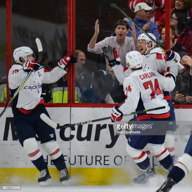 Fans react after Washington Capitals Center Jay Beagle scores the game winning goal with less than a second left in the third period during a game...