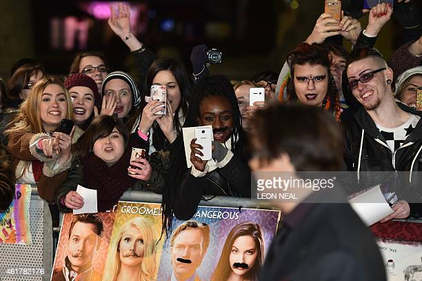 Fans react and take pictures as US actor Johnny Depp arrives for the UK premiere of the film 'Mortdecai' in London on January 19 2015 AFP PHOTO /...