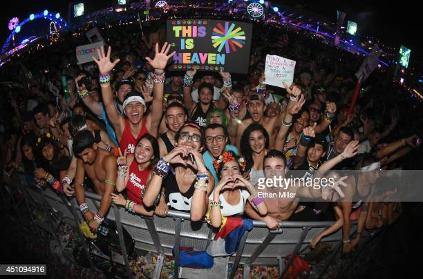 Fans react as Above Beyond performs during the 18th annual Electric Daisy Carnival at Las Vegas Motor Speedway on June 23 2014 in Las Vegas Nevada