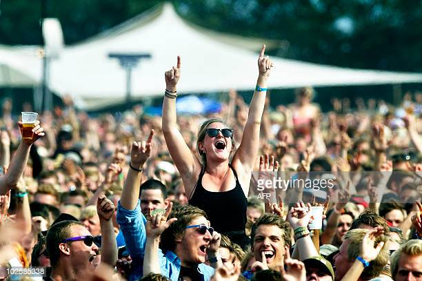 Fans react as Danish band Dizzy MIss Lizzy performs at the Roskilde Festival on Juy l2 2010 Some 75000 fans attend the festival in Roskilde 30 km...