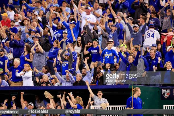 Fans react as Eric Hosmer of the Kansas City Royals hits a two run home run against the Cleveland Indians during the fifth inning at Kauffman Stadium...