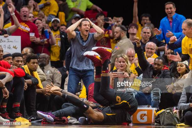 Fans react as LeBron James of the Cleveland Cavaliers tumbles to the floor after making an offbalance shot during the second half of Game 4 of the...