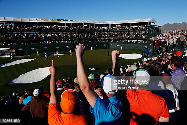 Fans react as Rickie Fowler putts on the 16th green during the second round of the Waste Management Phoenix Open at TPC Scottsdale on February 5 2016...