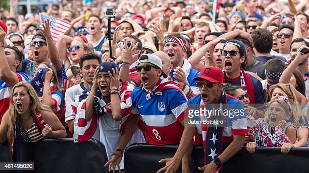 USA fans react as the US soccer team takes on Belgium in the World Cup at a viewing party at Redondo Beach Pier in Los Angeles on Tuesday July 01...