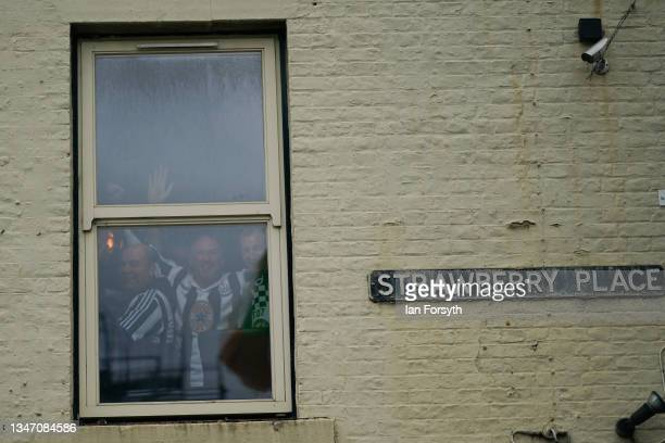 Fans react as they have a drink in the Strawberry Pub as Newcastle United has their first game since the club's takeover on October 17, 2021 in...