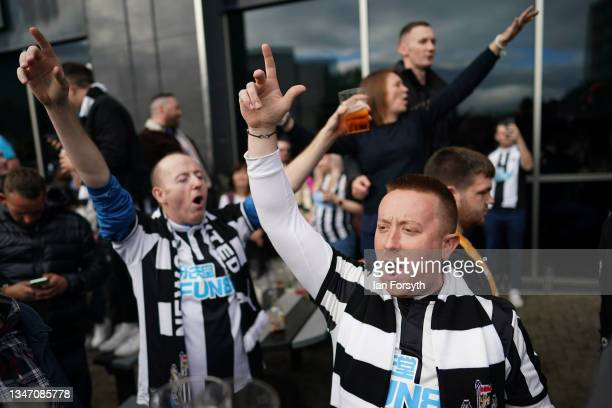 Fans react as they head to St James' Park football stadium before their game against Tottenham Hotspur and their first game after Newcastle United's...
