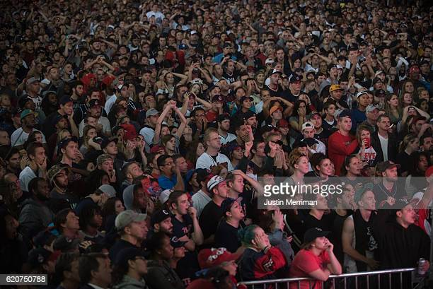 Fans react as they watch a big screen outside of Progressive Field during game 7 of the World Series between the Cleveland Indians and the Chicago...